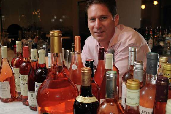 Brasserie 19 manager and wine buyer Shawn Virene shows the large selection of rosés.