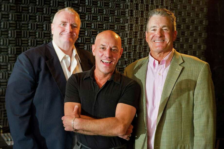 From left, James Daniel Entertainment General Manager Sean McKee, Creative Director Paul Lacano and President Jim Romaniello pose for a photo in a studio in the company's Bedford Street offices on Tuesday, August 5, 2014. Photo: Lindsay Perry / Stamford Advocate