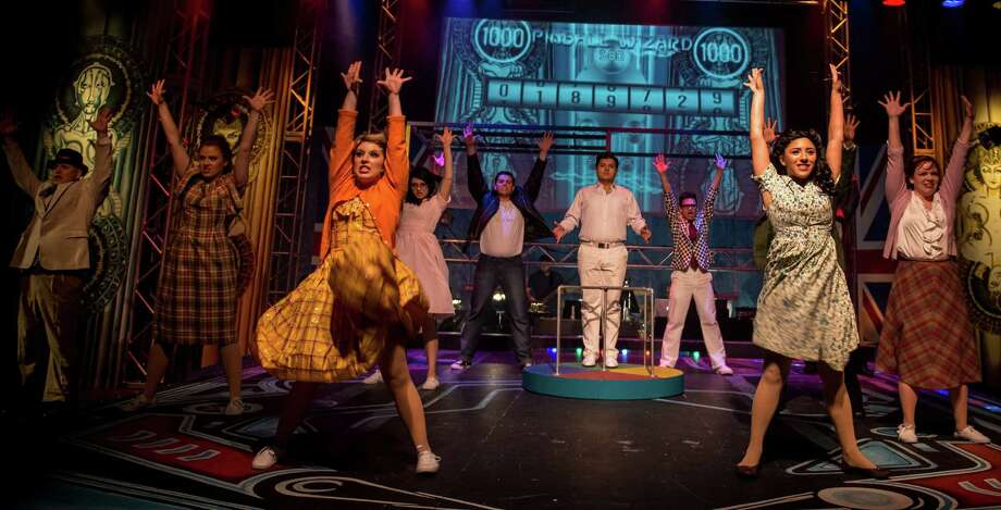 """The cast of """"Tommy,"""" currently playing at The Playhouse San Antonio, delivers a high-energy staging. Photo: Courtesy Siggi Ragnar / sRagnar"""