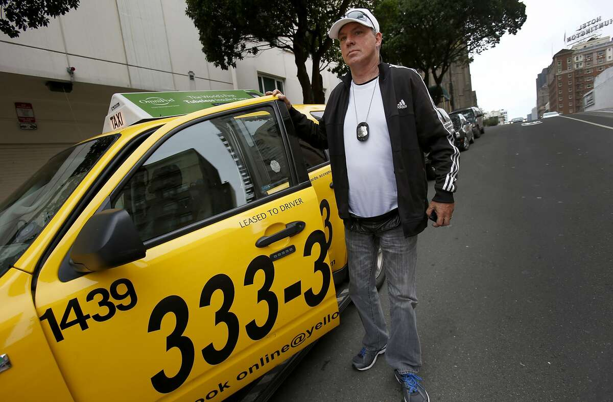 Yellow Cab driver John Lyman emerges from his car on California Street Tuesday August 5, 2014 in San Francisco, Calif. Yellow Cab taxi driver John Lyman uses an application called Taxi Magic, which will soon be called Curb, to get more fares in an effort to compete with on-demand services like Uber and Lyft.