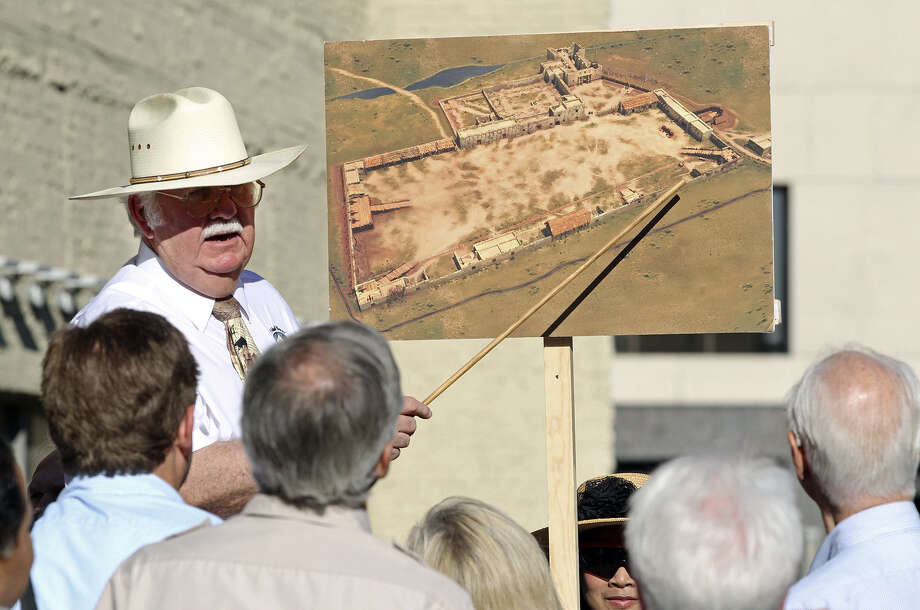John L. Hinnant points out locations on a drawing of the original Alamo compound boundaries as the city's Alamo Plaza Commission tours the site in May. Photo: Tom Reel / San Antonio Express-News / San Antonio Express-News