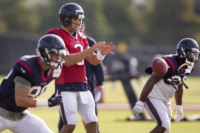 Quarterback Tom Savage (3) takes a snap from the shotgun.
