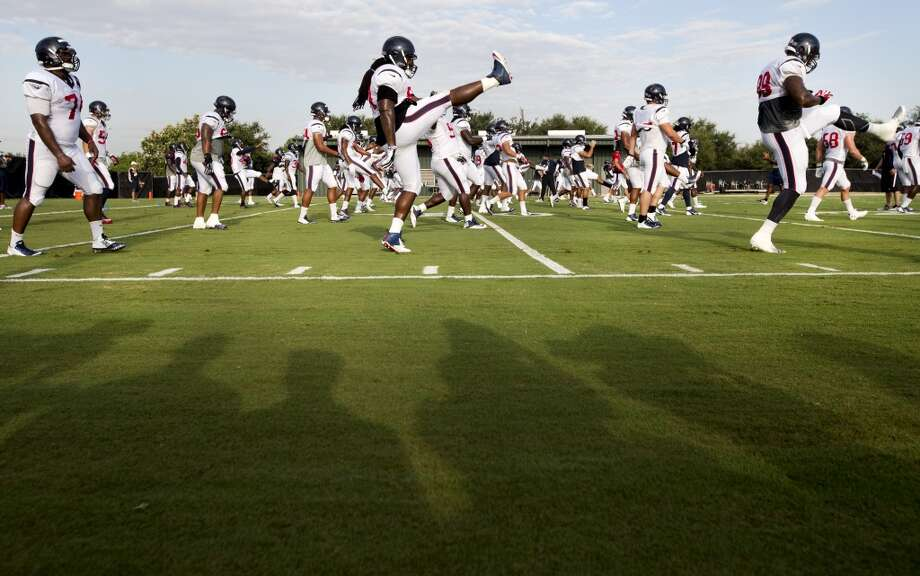 Texans players warm up before practice. Photo: Brett Coomer, Houston Chronicle