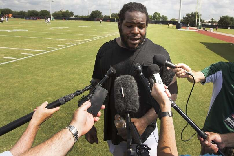Defensive tackle Ricardo Mathews stops to be interviewed by the media.
