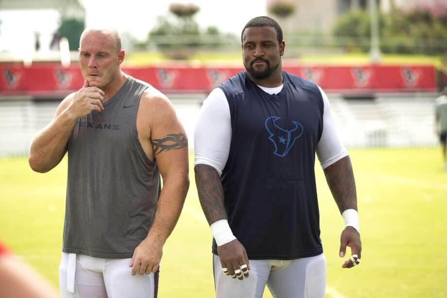 Center Chris Myers, left, and tackle Duane Brown stand together to have their photo taken. Photo: Brett Coomer, Houston Chronicle