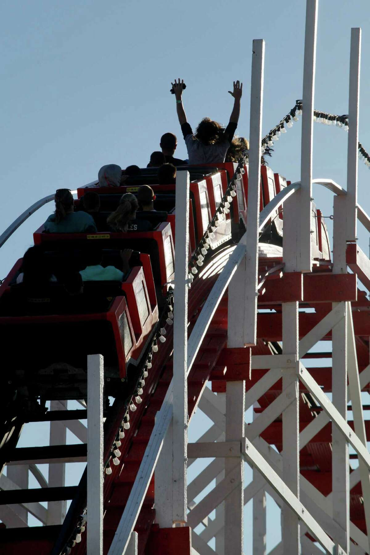Riders enjoy the Giant Dipper wooden roller coaster at the Santa Cruz Beach Boardwalk in Santa Cruz, Calif., on Wednesday, July 30, 2014. It's over 90 years old and is a National Historic Monument.
