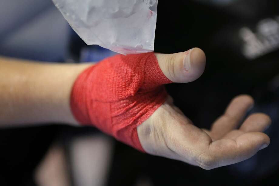 A member of the Hard Drivers ices a bandaged thumb after the match is over on Sunday. The Santa Cruz Derby Girls Seabright Sirens played the Silicon Valley Roller Girls Hard Drivers at Kaiser Permanente Arena in Santa Cruz, Calif., on Sunday, July 20, 2014. Photo: Carlos Avila Gonzalez, The Chronicle