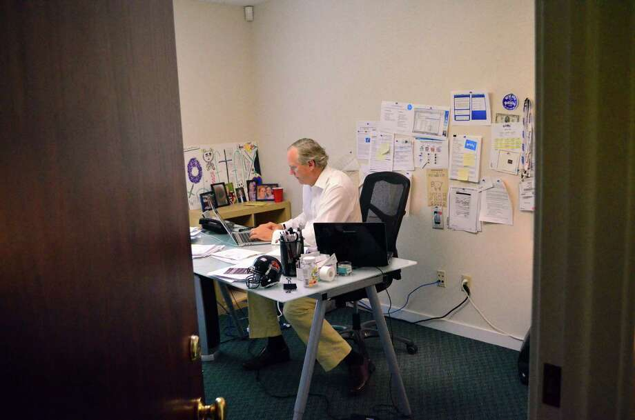 Giftfly app co-founder and CEO Cory Perkins works in his office at 381 Post Road in Darien. Photo: Megan Spicer / Darien News