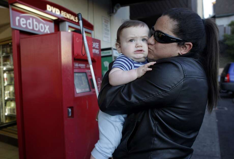 Lisamaria Martinez holds son Erik Bakker near a kiosk in 2012. She is the lead plaintiff in the lawsuit. Photo: Lacy Atkins, The Chronicle