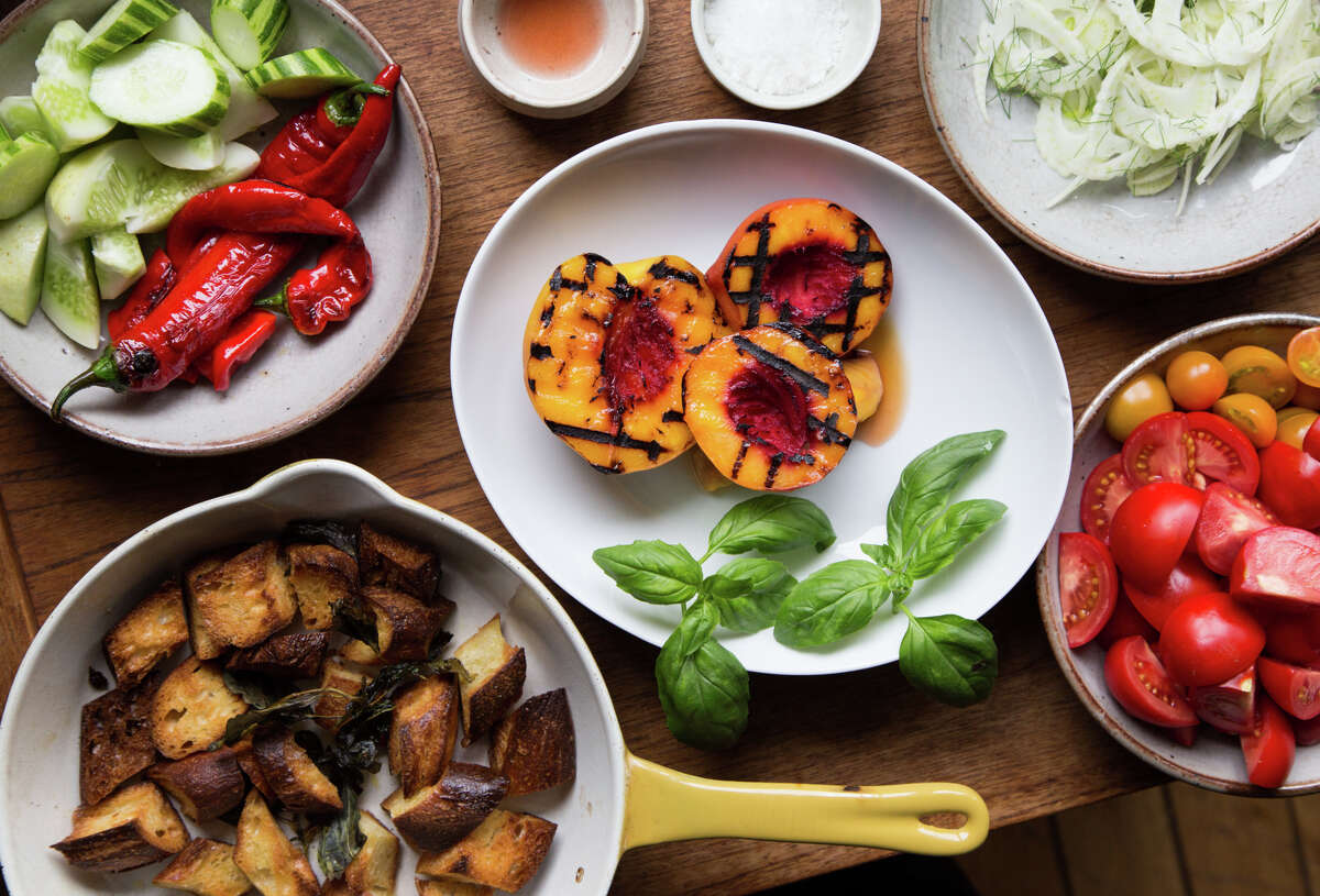 Melissa Perello, chef at Frances restaurant, uses a variety of ingredients for a panzanella salad including toasted levain bread, grilled stone fruit, fennel, tomatoes, peppers and cucumbers at her home in San Francisco, Calif., Thursday, July 31, 2014
