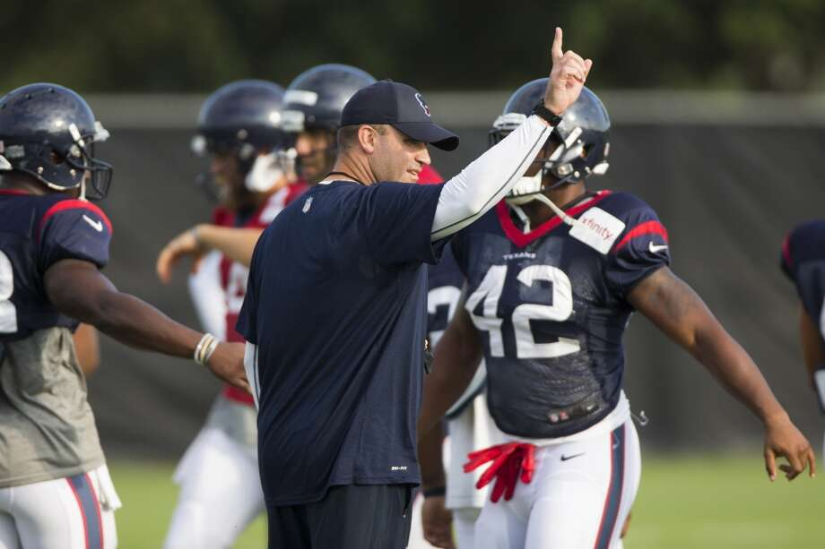 Bill O'Brien calls for the music to be turned up. Photo: Brett Coomer, Houston Chronicle