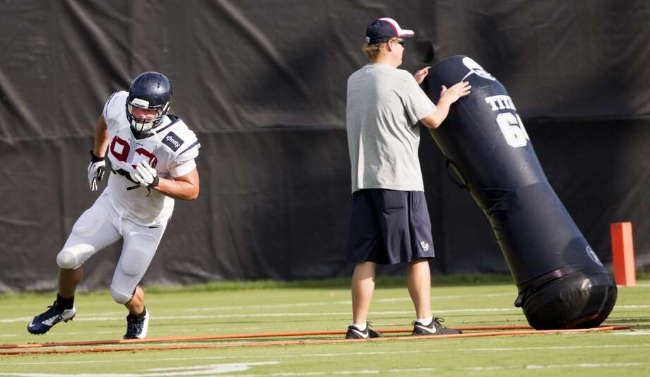 Texans defensive end Jared Crick runs a drill. Photo: Brett Coomer, Houston Chronicle