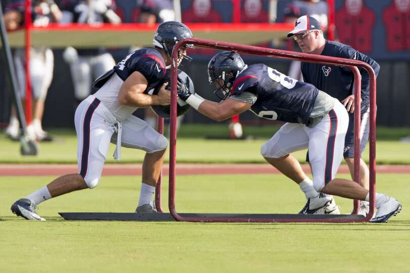 Texans tight ends Ryan Griffin (84) and Zach Potter (86) run through a blocking drill.