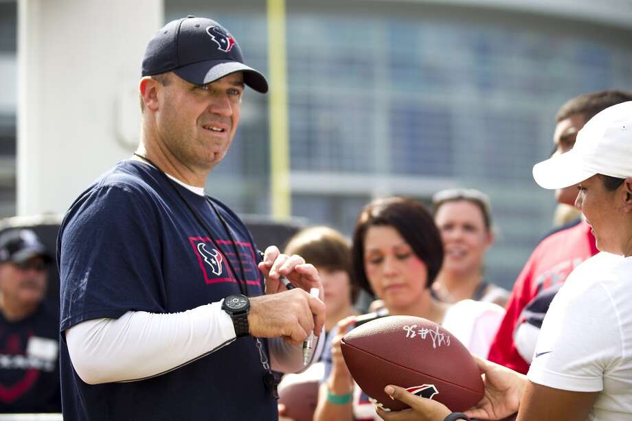 Bill O'Brien signs autographs after practice. Photo: Brett Coomer, Houston Chronicle