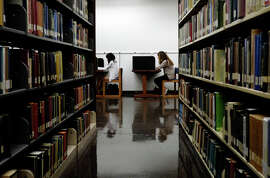 Students work in the library at California State University, Long Beach.