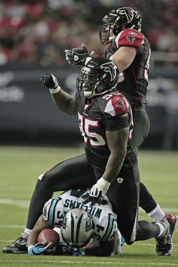 ** FILE ** In this Nov. 23, 2008 file photo, Atlanta Falcons defenders Jonathan Babineaux (95) and Keith Brooking (56) react after stopping Carolina Panther running back DeAngelo Williams (34) for a loss during an NFL football game in Atlanta.  on Sunday, Nov. 23, 2008. Brooking, the last remaining player from Atlanta's Super Bowl team, became a free agent Friday Feb. 27, 2009, after failing to work out a new contract with the Falcons. (AP Photo/Dave Martin, File) Photo: Dave Martin / Beaumont