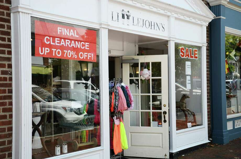 "After 24 years in New Canaan, Conn., Littlejohn's children's clothing store, 120 Elm St., is closing its doors Thursday, Aug. 14, 2014. Owner Anda Weyher said the rent for the location has become ""impossible"" to afford. Photo: Nelson Oliveira / New Canaan News"