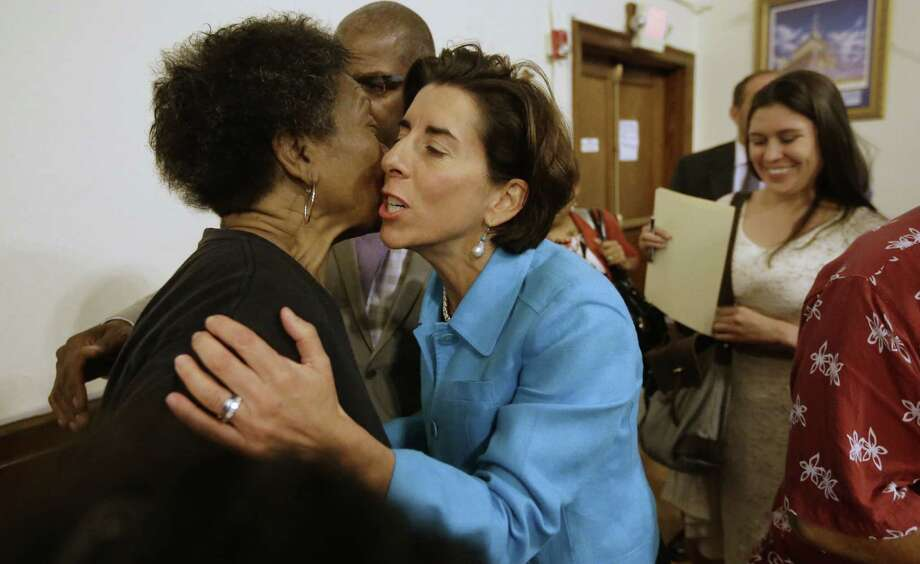 Rhode Island gubernatorial candidate Democrat Gina Raimondo (center)  is among Democrats seeking reform of rich public employee benefits that threaten to devolve into disaster. Photo: Steven Senne / Associated Press / AP