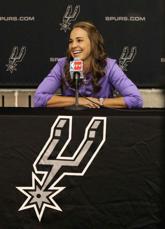 WNBA star player Becky Hammon speaks at a press conference after being hired as the NBA's first full-time assistant coach for the San Antonio Spurs on Tuesday, August, 5, 2014. Hammon is currently on contract with the WNBA San Antonio Stars but announced that she will retire at the end of the 2014 season. Hammon has played 16 years in the WNBA and is ranked first in free-throw percentage and was a six-time All-Star averaging 13.1 points per game. Photo: Kin Man Hui, San Antonio Express-News / ©2014 San Antonio Express-News