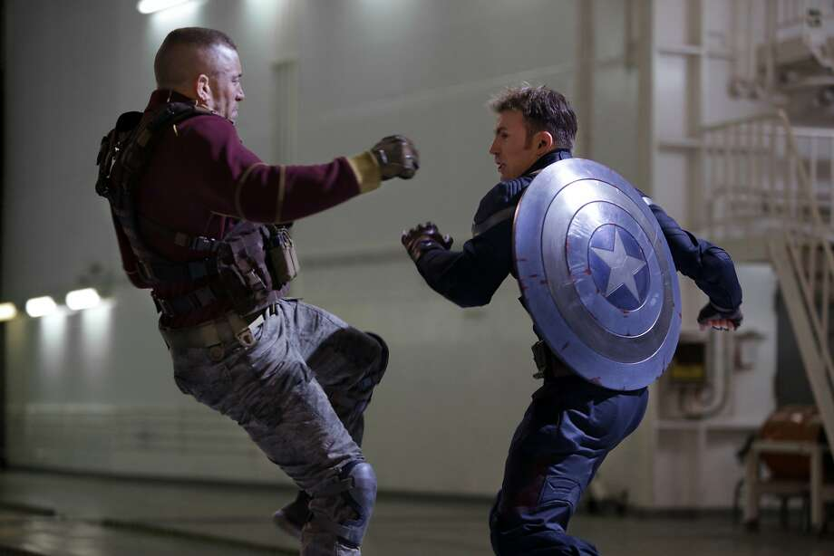 """Captain America: The Winter Soldier,"" starring Chris Evans (right), added to Disney's bottom line. Photo: Zade Rosenthal, Associated Press"