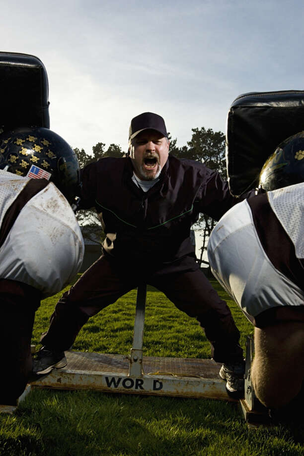 Boot camp conditions.  If you decide to join the armed services after high school you at least have a leg up on the other recruits when it comes to pain, misery, being denigrated by a superior, and ingesting your share of dirt. Photo: Ty Downing, Getty Images / (c) Ty Downing
