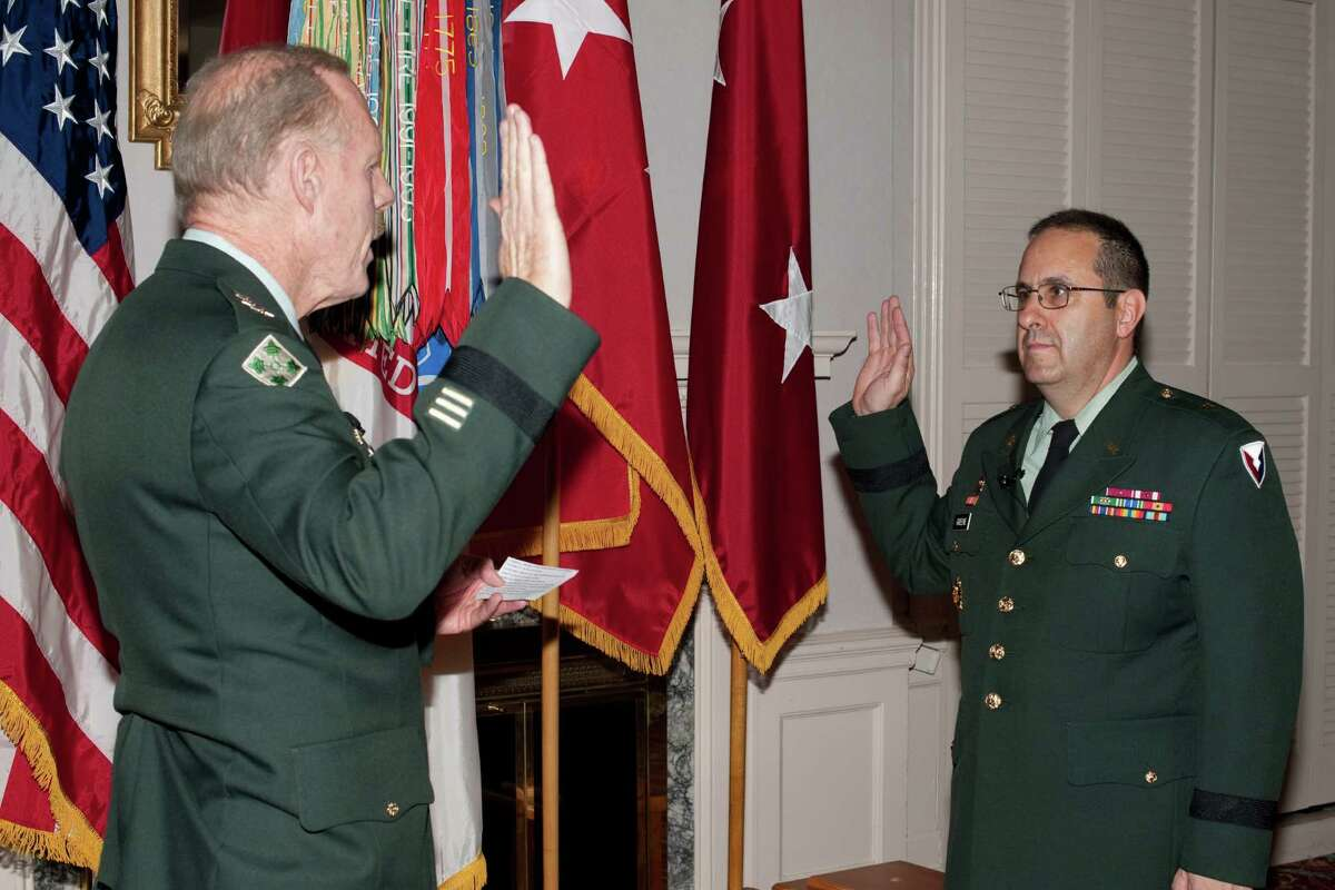 Lt. Gen. Stephen Speakes, deputy chief of staff, left, administers the oath of office to new Brig. Gen. Harold Greene, right, during a 2009 promotion ceremony at Aberdeen Proving Ground, Md. (U.S. Army photo)