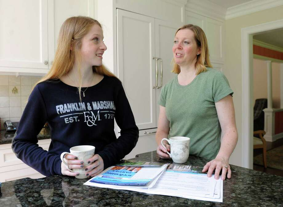 Kathy Riccio and her daughter Samantha spend time at their home in Redding, Conn. Thursday, July 31, 2014. Samantha is preparing to head off to Franklin and Marshall College in Pennsylvania in the fall. Photo: Autumn Driscoll / Connecticut Post freelance