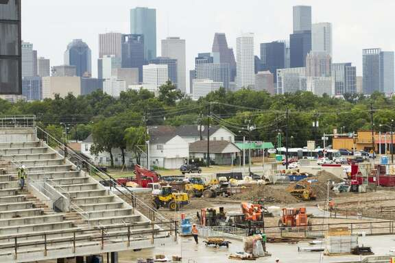 The city skyline can be seen through a corner of the new TDECU Stadium during a tour of the venue on the University of Houston Campus Tuesday, Aug. 5, 2014, in Houston. TDECU Stadium is scheduled to open on August 29, went UH plays the University of Texas-San Antonio. ( Brett Coomer / Houston Chronicle )