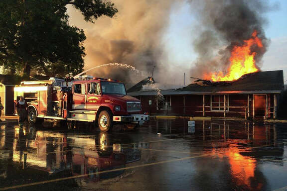 Flames rise Hinze's Bar-B-Que in Wharton after a pit fire broke out Monday.