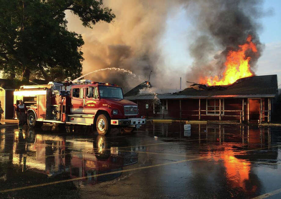 Flames rise Hinze's Bar-B-Que in Wharton after a pit fire broke out Monday. Photo: Wharton County Constables Office / Wharton County Constables Office