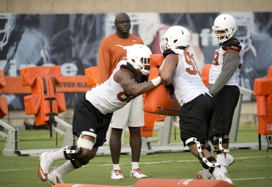 Coach Charlie Strong stripped the longhorn logos off the helmets to send a message: You have to earn it. Photo: Texas Sports, Courtesy