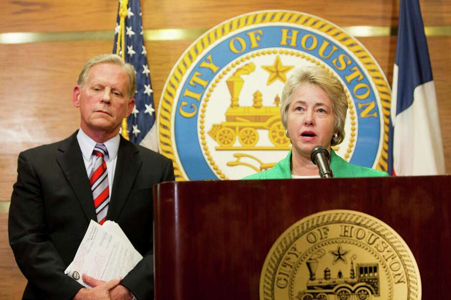 "Mayor Annise Parker and City Attorney David Feldman, announce that the petition to repeal the Houston Equal Rights Ordinance adopted by the City Council in May has fallen short of the number of signatures required due to errors in the signature collection process Monday, Aug. 4, 2014, in Houston. The 15,249 valid signatures fell short of the 17,269 required. Pages of signatures didn't qualify due to ""irregularities and problems."" ( Johnny Hanson / Houston Chronicle ) Photo: Johnny Hanson, Staff / © 2014  Houston Chronicle"