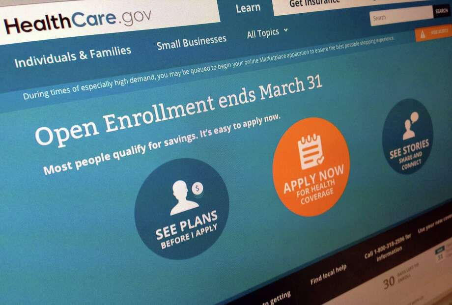"FILE - This March 1, 2014 file photo shows part of the website for HealthCare.gov, seen in Washington. President Barack Obama's health care law has become a tale of two Americas. States that fully embraced the law's coverage expansion are experiencing a significant drop in the share of their residents who remain uninsured, according to an extensive new poll released Tuesday. States whose leaders still object to ""Obamacare"" are seeing much less change. The Gallup-Healthways Well-Being Index, cumulatively based on tens of thousands of interviews, found a drop of 4 percentage points in the share of uninsured residents for states that adopted the law's Medicaid expansion and either built or helped run their own online insurance markets. (AP Photo/Jon Elswick, File) Photo: Jon Elswick, STF / AP"