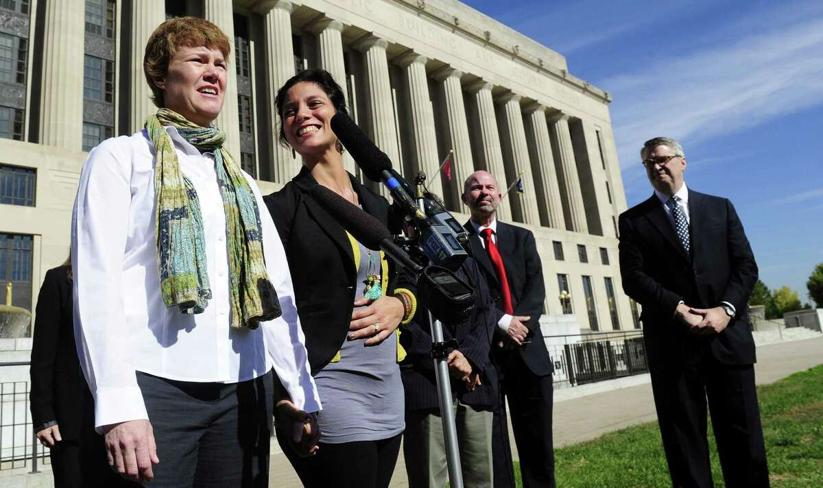 Dr. Sophy Jesty (left) and Dr. Valeria Tanco of Knoxville, Tenn., outside Davidson County Courthouse in Nashville last October, are part of a group that sued to force Tennessee to recognize same-sex marriages from other states.