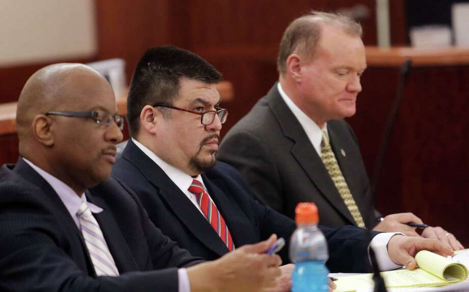 Defendant Jorge Alberto Amezquita, center, sits with attorneys Alvin Nunnery, left, and Danny Easterling, during the start Tuesday of Amezquita's capital murder trial in Pasadena. Photo: Billy Smith II, Staff / © 2014 Houston Chronicle