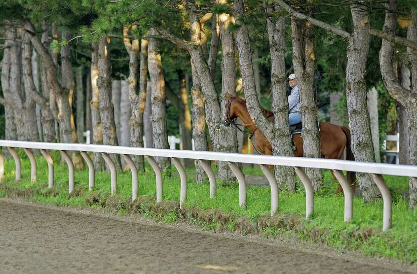 Trainer Tom Voss and his horse, John's Call, are at the Oklahoma Training Track at Saratoga in 2008.