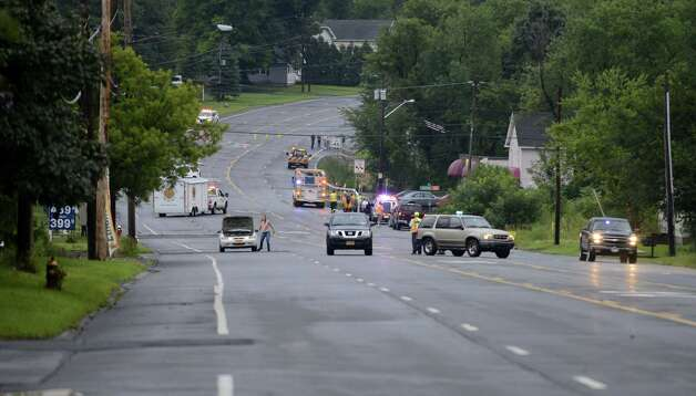 Emergency workers closed Route 2 after a fast moving storm caused flooding at the intersection of Troy Schenectady Rd. (Route 2) and Monroe Ave. Tuesday afternoon, Aug. 5, 2014, in Colonie, N.Y. (Will Waldron/Times Union) Photo: WW, Albany Times Union
