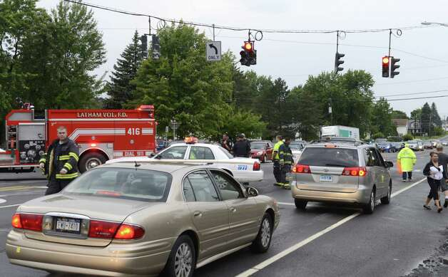 Emergency workers closed Route 2 at the intersection of Park Ave. after a fast moving storm caused flooding at the intersection of Troy Schenectady Rd. (Route 2) and Monroe Ave. Tuesday afternoon, Aug. 5, 2014, in Colonie, N.Y. (Will Waldron/Times Union) Photo: WW, Albany Times Union
