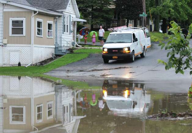 A fast moving storm caused flooding at the intersection of Troy Schenectady Rd. (Route 2) and Monroe Ave. Tuesday afternoon, Aug. 5, 2014, in Colonie, N.Y. Route 2 was temporarily closed. (Will Waldron/Times Union) Photo: WW, Albany Times Union