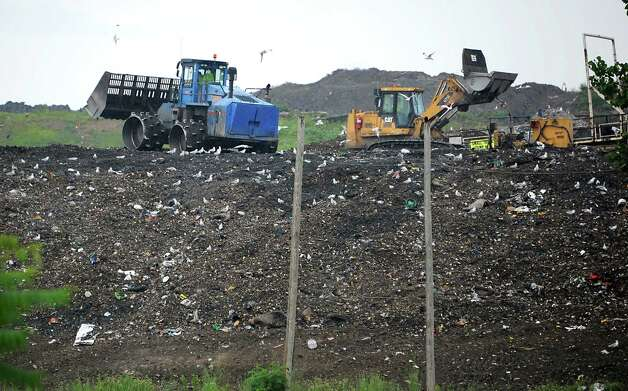 Tractors move solid waste at the Colonie Landfill on Tuesday, Aug. 5, 2014 in Colonie, N.Y. (Lori Van Buren / Times Union) Photo: Lori Van Buren / 00028060A