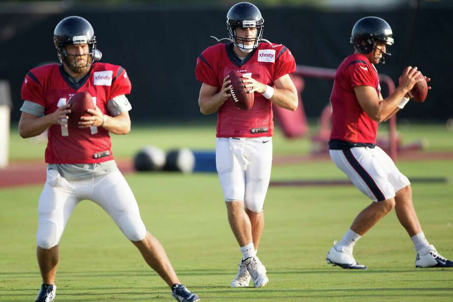 As the Texans prepare for Saturday's preseason opener at Arizona, quarterbacks, from left, Ryan Fitzpatrick, Case Keenum and Tom Savage are working to get a handle on coach Bill O'Brien's offense. Photo: Brett Coomer, Staff / © 2014 Houston Chronicle