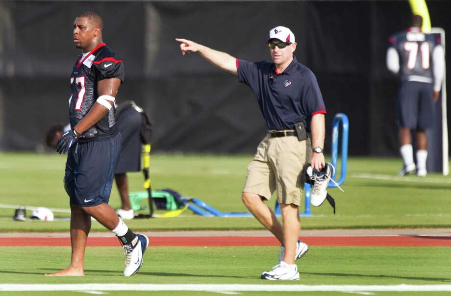 Houston Texans linebacker Sam Montgomery, left, walks off the field with trainer Geoff Kaplan after injuring his ankle during Texans training camp at the Methodist Training Center Friday, July 26, 2013, in Houston.  ( Brett Coomer / Houston Chronicle ) Photo: Brett Coomer, Staff / © 2013 Houston Chronicle