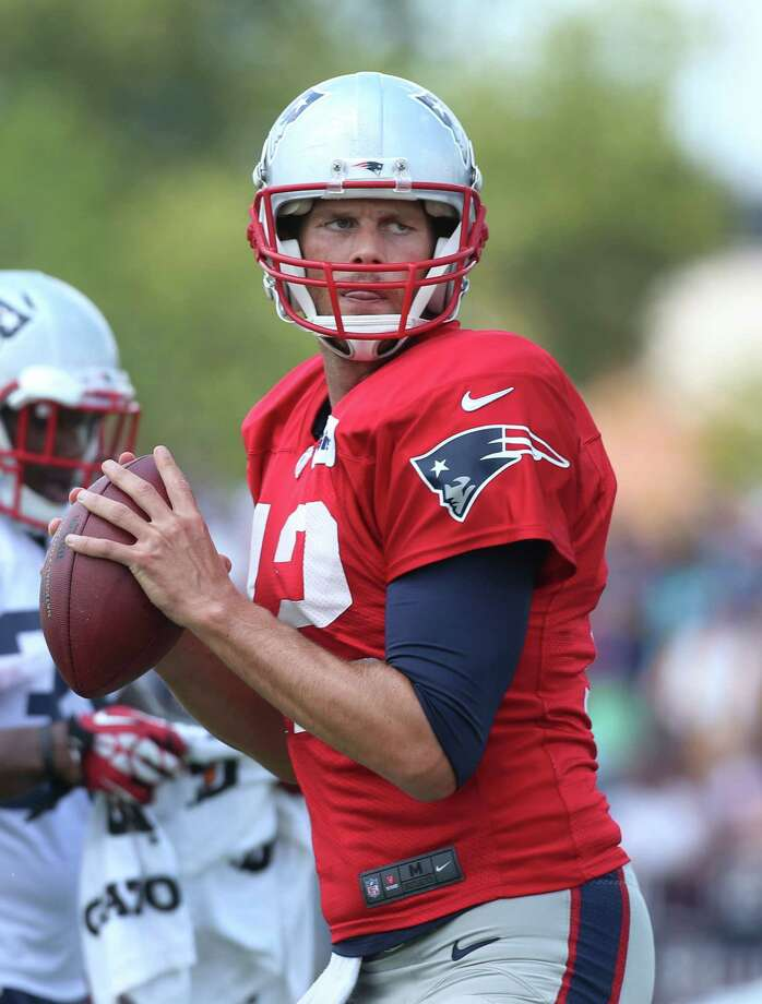 New England Patriots' quarterback Tom Brady gets set to pass during a drill during a scrimmage with the Washington Redskins  at the  Redskins Training Center, Tuesday, Aug. 5, 2014, in Richmond, Va. (AP Photo/Richmond Times-Dispatch, P. Kevin Morley)   ORG XMIT: VARIT301 Photo: P. Kevin Morley / Richmond Times-Dispatch
