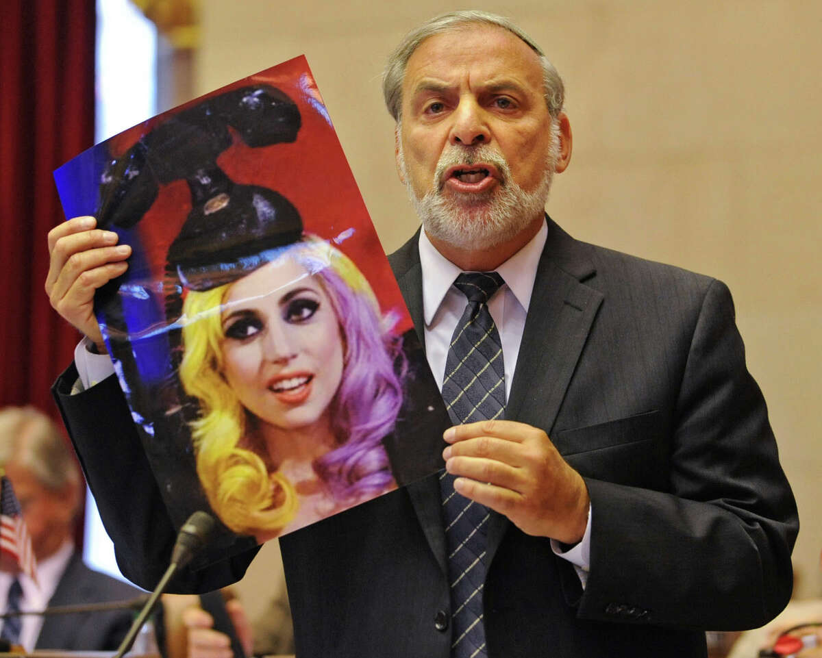 Dov Hikind holds up a photo of Lady Gaga as he speaks against same-sex marriage before the vote on marriage equality Wednesday, June 15, 2011, at the Capitol in Albany, N.Y. (Lori Van Buren / Times Union archive)