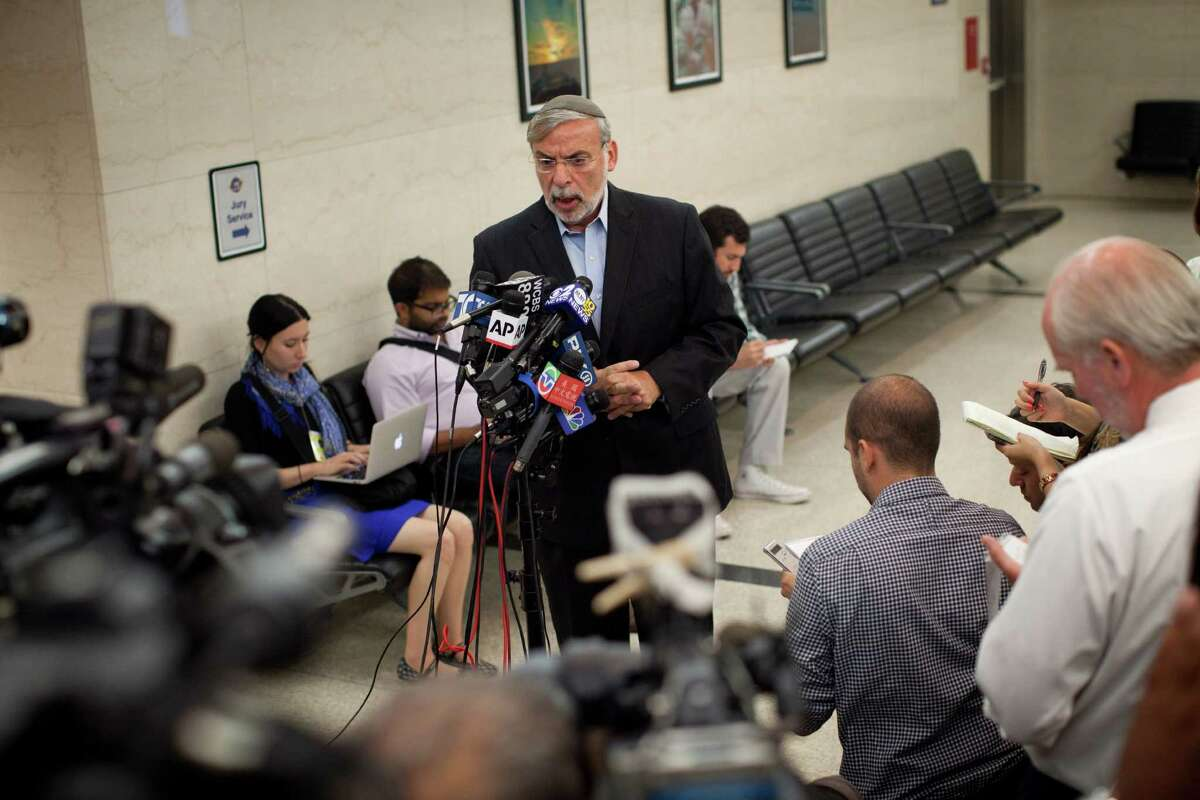 Assemblyman Dov Hikind, of the New York State Assembly, speaks to reporters after leaving a courtroom where Levi Aron was sentenced in New York, Aug. 29, 2012. (Richard Perry/The New York Times)