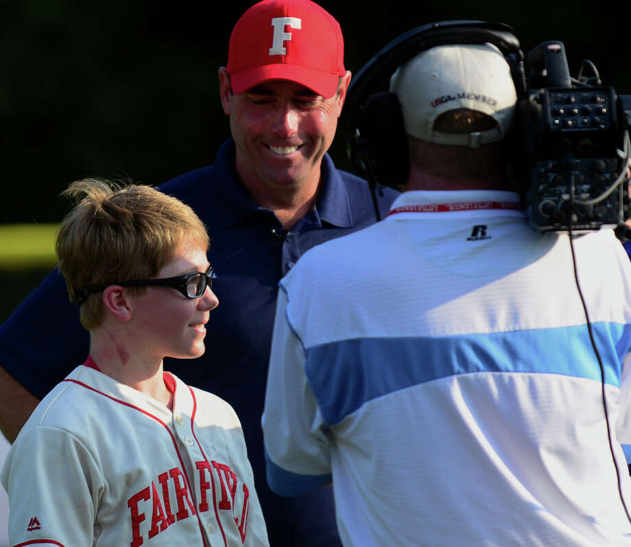 Fairfield American's Jamie Flink talks to a television crew as Manager Mike Steed proundly looks on, after New England little league tournament action against Rhode Island in Bristol, Conn. on Saturday August 2, 2014. Flink hit a 2 run home run to beat Rhode Island 5-3. Photo: Christian Abraham / Connecticut Post