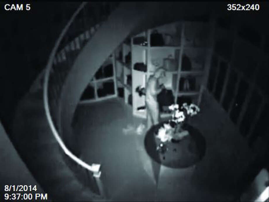 Montgomery County authorities hope video from an infrared security camera will help identify the jump-suited intruder who burgled a 3,000-square-foot closet in a mansion in TheWoodlands, stealing $1 million worth of luxury items. Photo: Montgomery County Sheriff / handout