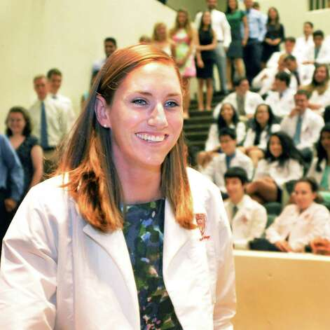Medical student Cara Sprague of Queensbury receives her first white medical coat during the annual white coat ceremony to welcome new medical students to Albany Medical College Tuesday afternoon, Aug. 5, 2014, in Albany, N.Y. Students in the class of 2018 recited the Hippocratic Oath during their first day of school. (John Carl D'Annibale / Times Union) Photo: John Carl D'Annibale / 00028045A