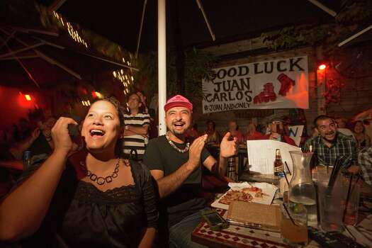 "Carolyn Casey, left, and artist Gonzo247, cheer as more than 100 people gather Tuesday, Aug. 5, 2014, at Boheme in Houston to celebrate Juan Carlos Restrepo as he competes on ""America's Got Talent."" Photo: Johnny Hanson, Houston Chronicle / © 2014  Houston Chronicle"
