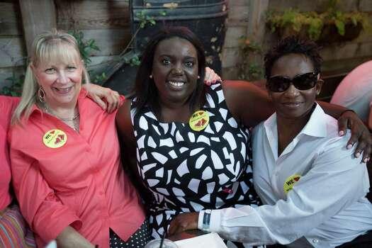 Jody McDonald, left, Jamil Thomas and Demetria Charles join Juan Carlos fans at Boheme for Tuesday night's watch party. Photo: Johnny Hanson, Houston Chronicle / © 2014  Houston Chronicle
